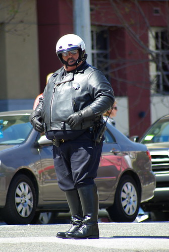 Road Block: Motorbike cop stopping traffic for the olympic torch going down Van Ness in San Fran | by mathewbest