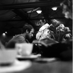 a customer, a waiter, flowers and two empty cups | by [kren]