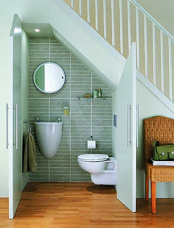 Under stairs closet bathroom for Closet bathroom suites