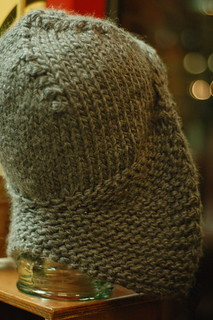 Green knitted hat with earflaps at Wolcotts f19bd34f4f57