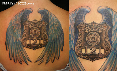 Badge with wings memorial custom tattooing by kevin rile for New tattoo laws