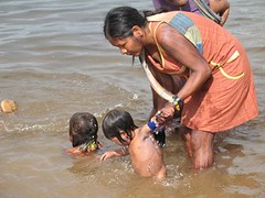Kayapó Women Bathing Children in Xingu | by International Rivers
