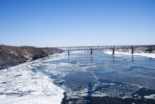 Bridge over icy waters | by Katy Silberger