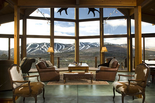 View out prow front wall of glass to ski slopes for Lindal log cabin homes