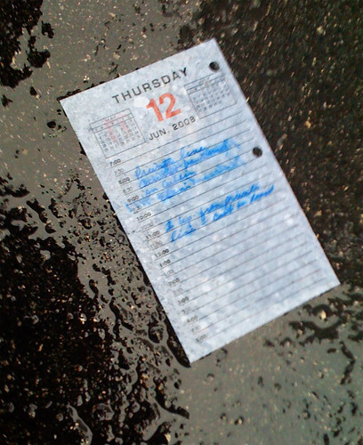 Found Item: Dayplanner on Rainy Pavement | by anitakhart
