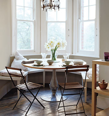 Pale green dining area + pedestal table + banquette seating | by SarahKaron