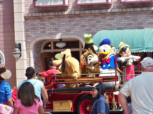 Disney characters arrive by Fire Engine | by Castles, Capes & Clones