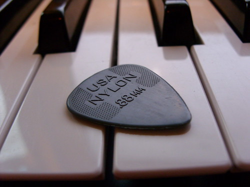 Plectrum and keyboard | by west.m