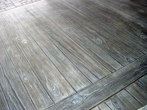 Faux wood finish on concrete patio | by avalonsculpture