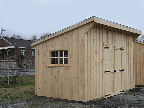 Storage shed wooden storage shed with single sloped roof for How to build a sloped roof shed