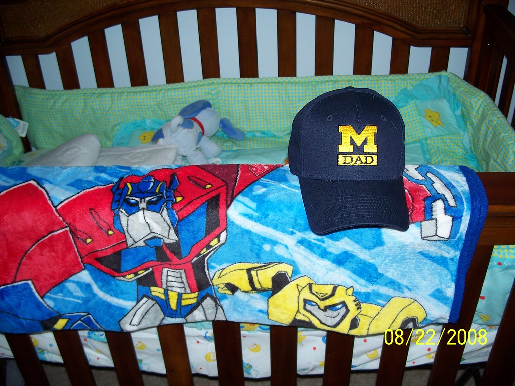 by JTKranix Logan s Transformers Animated blanket and my University of  Michigan Dad hat.  6990abcb985
