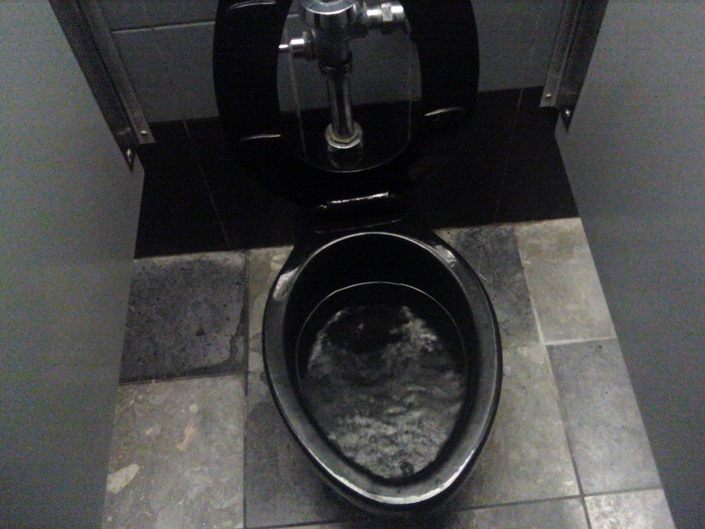 Black Toilets | Our local cheap theatre still has their age-… | Flickr