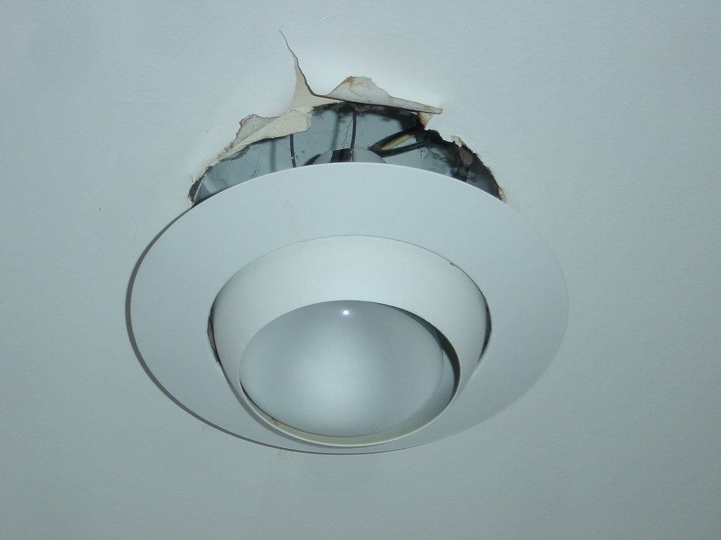 Damaged kitchen ceiling and light fixture | Water from crack… | Flickr