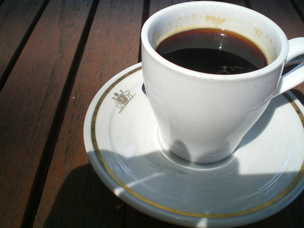 cup, saucer and coffee on table | note the australian coat o… | flickr