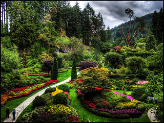 Two people visit Butchart Gardens on a cloudy day and stand motionless long enough for a 5x HDR | by ecstaticist - evanleeson.com