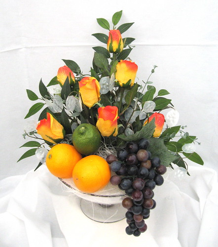 Fruit and flower arrangement made up from a selection of