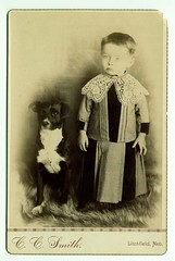 Child with lace collar, posed with dog | by George Eastman House