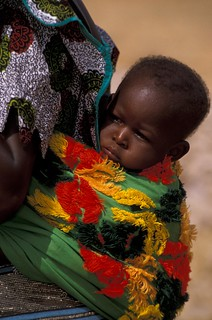 Child being carried | by World Bank Photo Collection