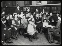 Work with schools : a librarian's assistant telling a story ... | by New York Public Library