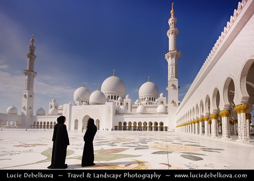 United Arab Emirates - Abu Dhabi - Sheikh Zayed Grand Mosque and two women in abaya | by © Lucie Debelkova / www.luciedebelkova.com