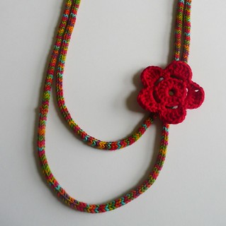 Rainbow necklace with red flower | by strawberrycards