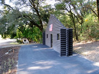 "Cady Noland's ""Log Cabin Blank With Screw Eyes and Cafe Door (Memorial to John Caldwell)"" 
