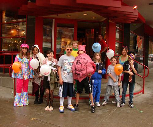 kids posing for a halloween group photo outside red robin spokane by lloyd n
