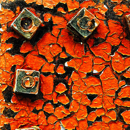 Rust And Cracked Paint On An Old Tank At A Compressor