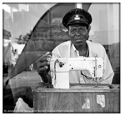a sewing man | by PhotoA.nl