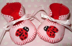 pink and red handmade baby booties with wonderful ladybirds motifs | by Funky Shapes