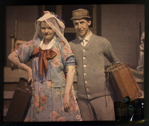 Man and women carrying suitcases | by George Eastman Museum