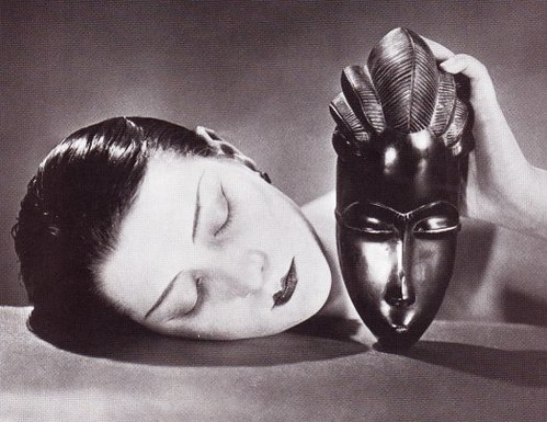 Man Ray, Kiki with African mask. Image via Flickr.