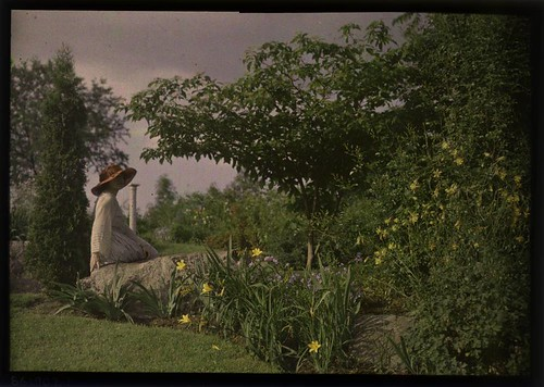 Ethel Dietz Nichols sitting on rock in garden | by George Eastman Museum