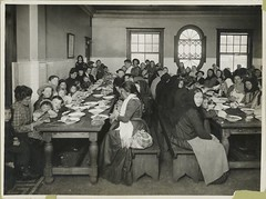 Uncle Sam, host. Immigrants being served a free meal at Elli... | by New York Public Library
