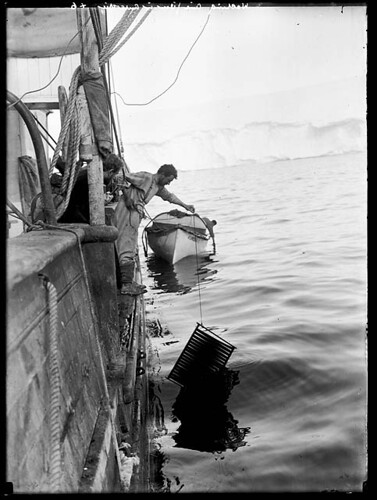 "Frank Hurley washing cinematograph film on the ""Aurora"" 