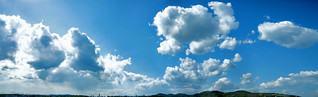 photomerge of a blue sky with clouds 9200x2800 | by viZZZual.com