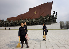Girls cleaning in Grand Monument on Mansu Hill - North Korea | by Eric Lafforgue