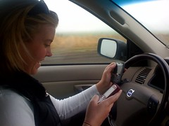 Meghan, using two cell phones while driving | by Ryan Harvey