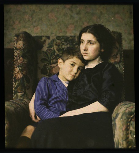 Woman and boy sitting in chair | by George Eastman Museum