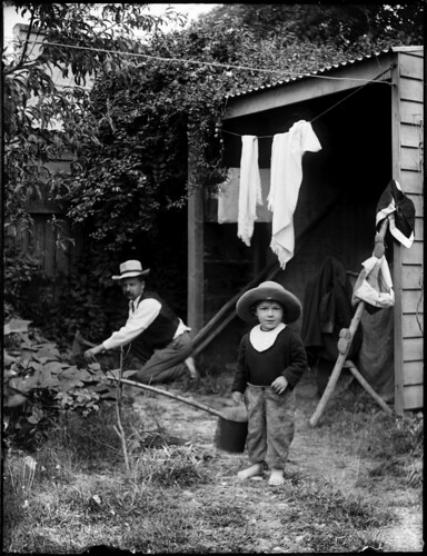Domestic backyard scene with man chopping kindling | by Powerhouse Museum Collection