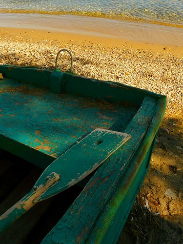 Green boat and sandy beach | by Marite2007
