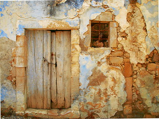 chained door barred window - Magarites - Crete | by mjja