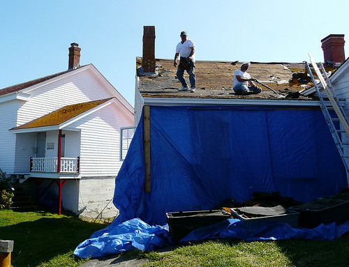 The Shingles Coming Off The Roof In Big Chunks Head