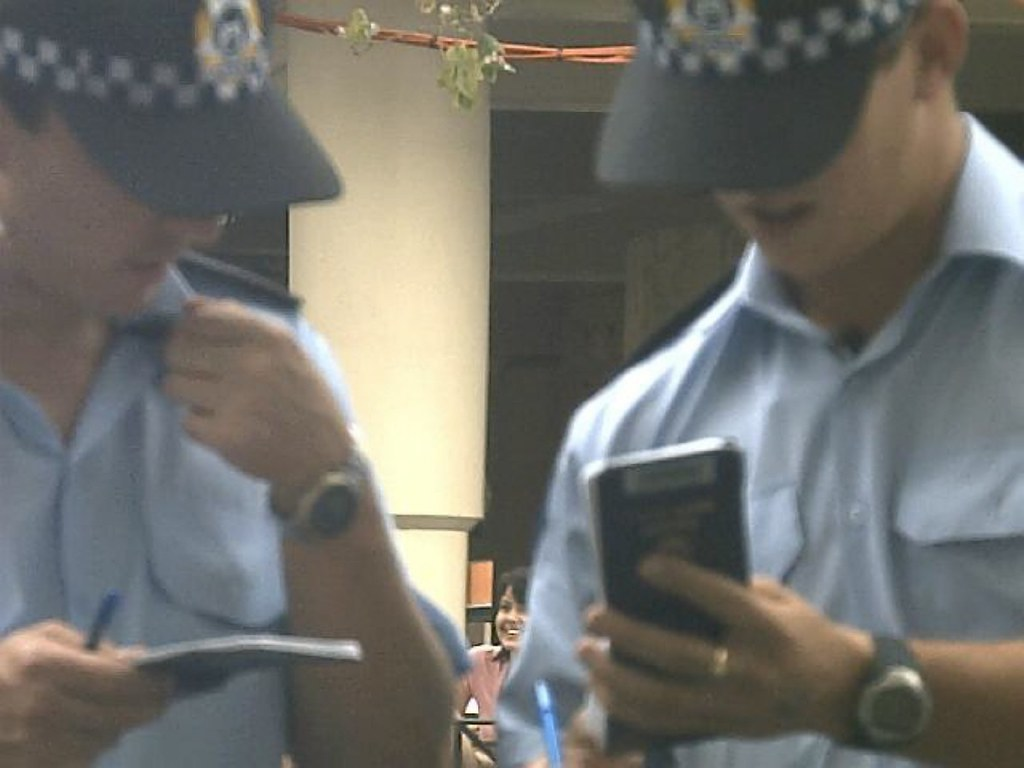Perth police officers doing a name check on youth in troub