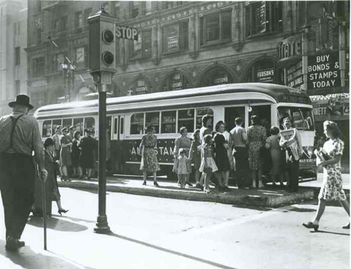 Car 3016 northbound on Broadway at 7th Street In War Bond and Stamps livery | by Metro Transportation Library and Archive