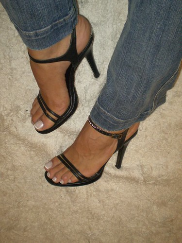 Sexy feet in high heel sandals