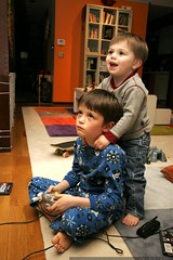 nick gets an unsolicited backrub from a two year old fan while he plays video games - _MG_3371 | by sean dreilinger