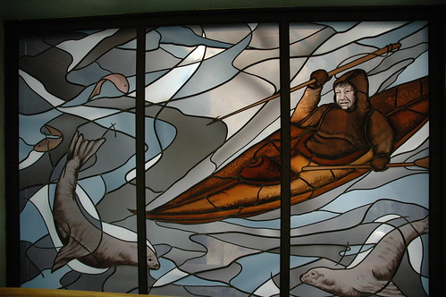 Eskimo man, with harpoon, water and ice, stained glass window, Alaska Pioneer's Home, Anchorage, Alaska | by Wonderlane