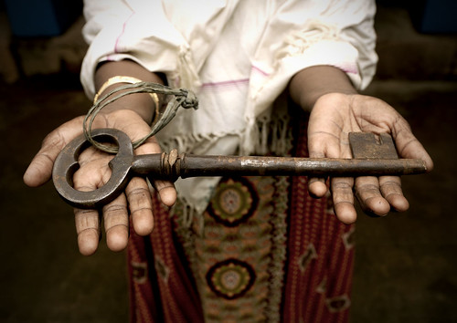 Holding Out The Giant Key To A Mansion In Kanadukathan, Chettinad, India | by Eric Lafforgue