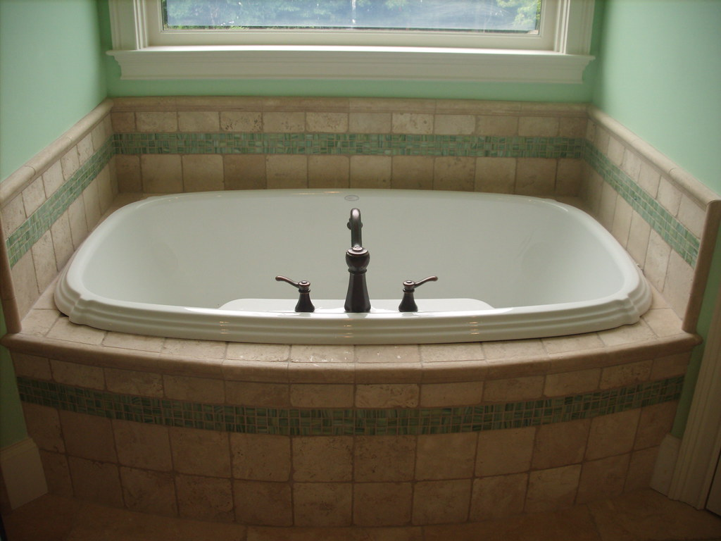 tile tub surround | travertine tub surround w/ a green glass ...